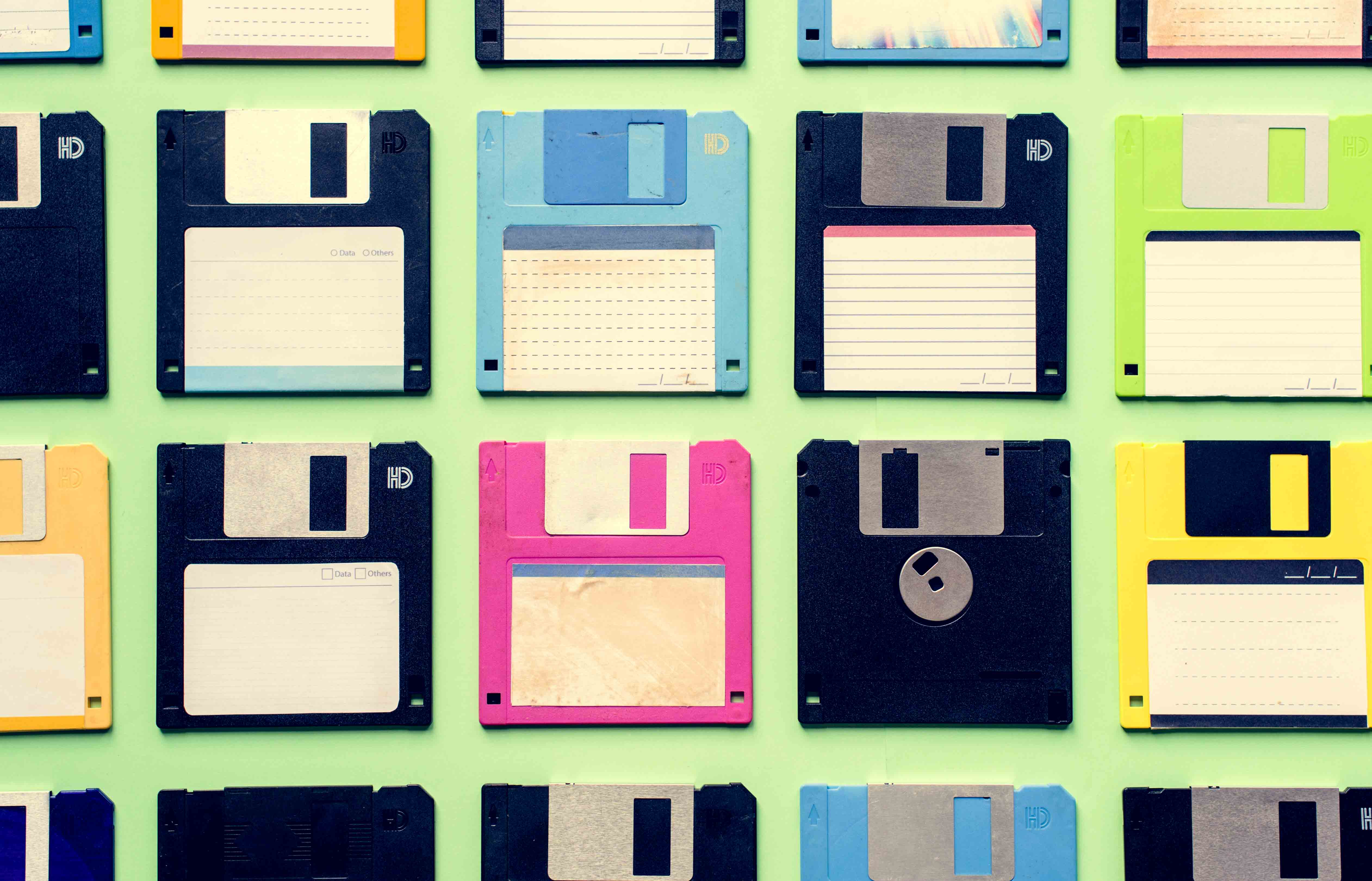 A group of diskettes arranged on a flat surface.